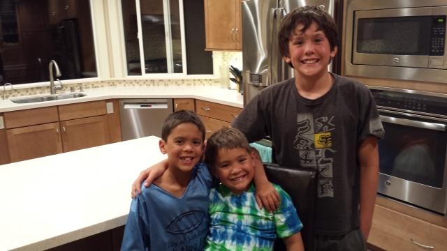 Brady, Derrick, and Casey Eddings in their new kitchen