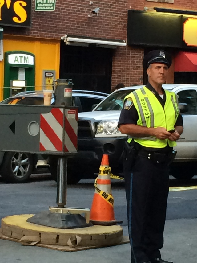 Robin liked this picture of one of Boston's finest (and his coffee from Dunkin Dounuts