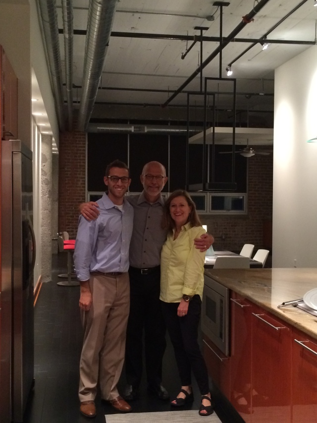 Daniel with his parents in his new loft.