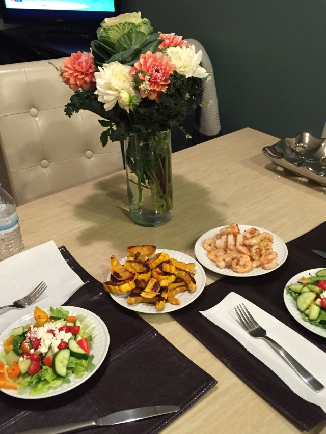 Home cooked dinner: prawns and flowers from Pike Market, delicata squash (compliments of Ellen in Portland), salads