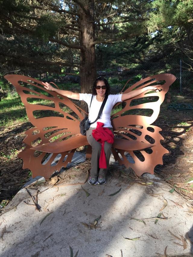 Enjoying the butterfly bench