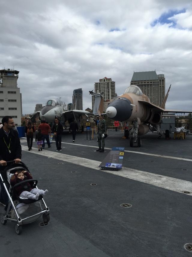 An F-14 (top gun) and newer F-18 on the flight deck